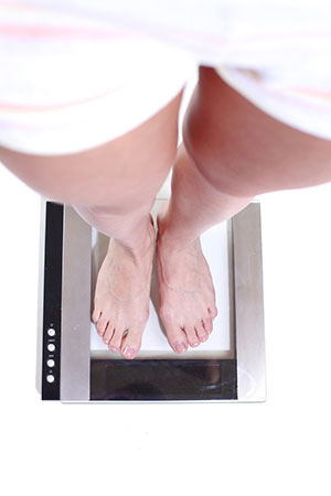 Woman Weighing Herself
